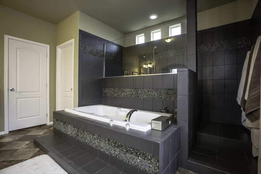 Ceramic tile details in a custom master bathrroom